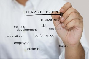 Man in white shirt write a Human resource concept